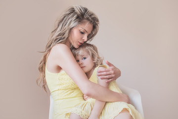 Mother holding her daughter in her arms