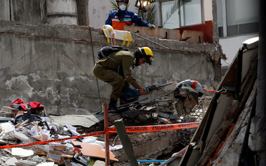 An Israeli rescue team searches for survivors in the rubble of a collapsed building after an earthquake in Mexico City