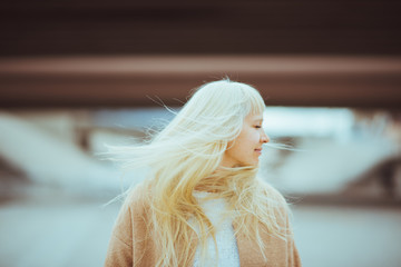 Woman closes her eyes in wind