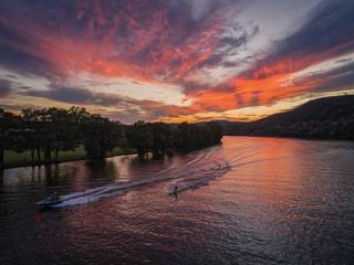 Speeding boat and waterski on Lake Austin in Austin,Texas during sunset