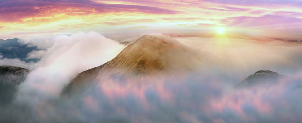 Wall Mural - Autumn mountains in the fog in the Carpathians. Low clouds are especially photogenic and picturesque.