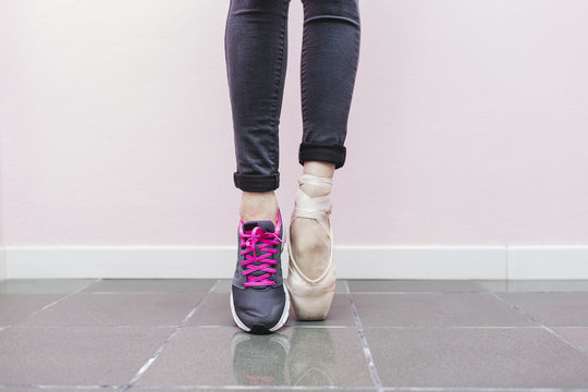 Dancer with dance shoe and sneaker