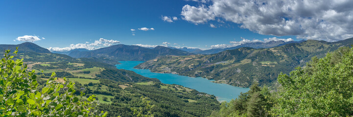 Panorama of the French Alpes. View over the Lac de Serre Poncon and the surrounding mountains.