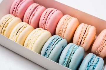 Aluminium Prints Macarons Colorful assorted macaroon cookies in a gift box
