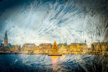 View through window with iceflowers onto Christmas Market in Hamburg