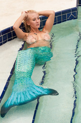 Blonde woman wearing a mermaid tail