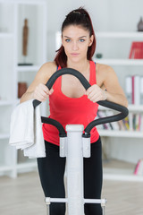 beautiful young woman using a step machine during a workout