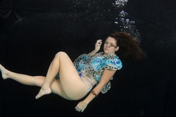Woman wearing a swimsuit underwater.