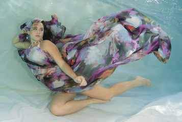 Young woman in a crochet swimsuit underwater.