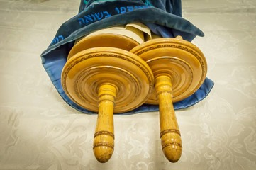 "Classical Torah scrolls in a blue case. They are used in different religious services in a synagogue, especially during the holidays of the Jewish ""tishrei"" month."