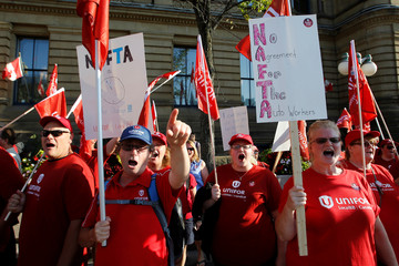 Members of Canada's Unifor union chant during a rally ahead of the third round of NAFTA talks in Ottawa
