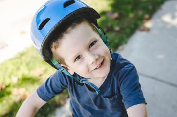 Smiling child in a bike helmet