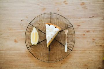 slice of lemon cake with lemon segment and fork