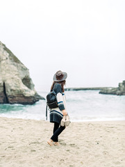 Young woman walking on beach