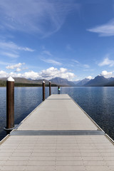 Woman on Lake McDonald Pier in Glacier National Park