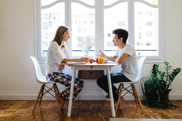 Couple sitting at the table in morning