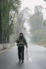 Traveller with backpack walking forward