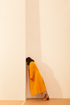 young lady with long yellow coat