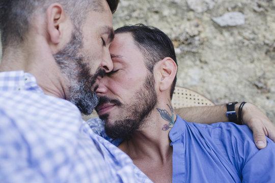 Two men in love embrace tenderly
