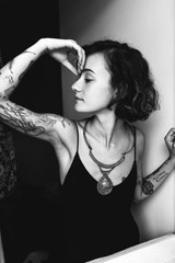Young tattooed bohemian woman