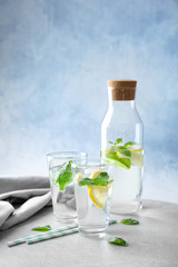 Basil water in glassware on table