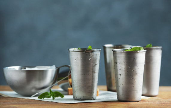 Glasses with mint julep on kitchen table