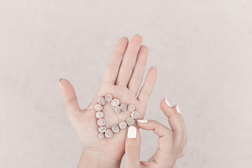 close up of woman hands holding sea shells