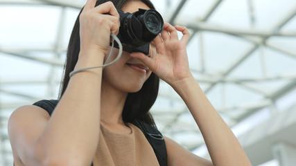 Female photographer taking photo
