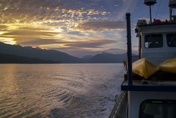 Cruising the Inside Passage Through Southeast Alaska. A boat trip traveling through the inside passage of Alaska during a glorious summer sunset.