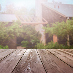 wooden table top with blurred outside farmhouse background
