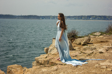 Girl in blue dress on a cliff 3