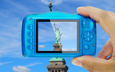 Taking picture of statue of liberty new york city compact camera display pov