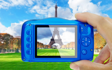 Taking picture of eiffel tower paris compact camera display pov