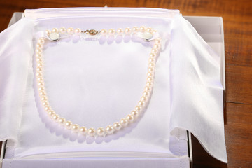 Pearls strand on white background