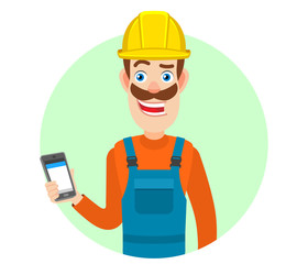 Builder holding mobile phone in hand