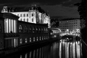 Central streets of Ljubljana Slovenia at night water channel window lights reflected in water beautiful architect
