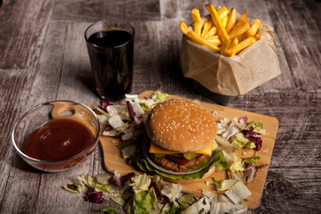 Over top view of Delicious tasty burgers on wooden background. Fast and tasty food