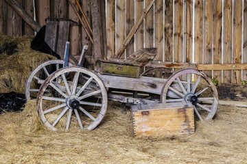 wooden barn is beautiful and the old horse cart