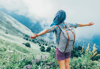 Freedom traveler woman in mountains.