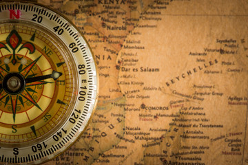 Close up compass on the vintage map