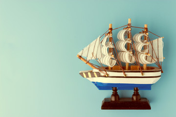 Toy ship on blue backround