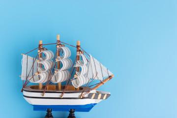 Toy ship on blue backround