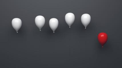 Einzelner roter Ballon neben weißen Ballons grauer Hintergrund