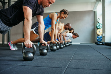 People doing pushups together in a health club class