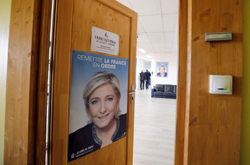 A poster with picture of Member of parliament Marine Le Pen of France's far-right National Front (FN) political party is pictured on a door of regional headquarter in Toulouse