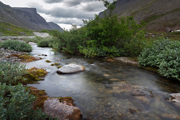 River with clean water in the mountains of Khibiny, Kola Peninsula, Russia.