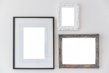Vintage empty wooden frame on white concrete wall