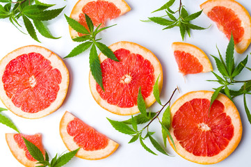 Grapefruit slices and marijuana leaves