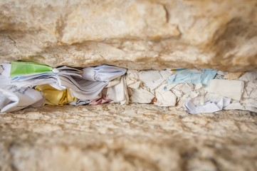 "A fragment of the Western wall (Wailing wall or ""Kotel"") with notes to God in the Old city of Jerusalem, Israel."