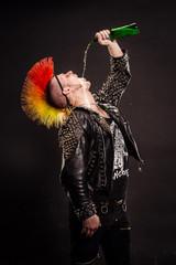 Portrait of punk rocker with Mohawk on a black background.